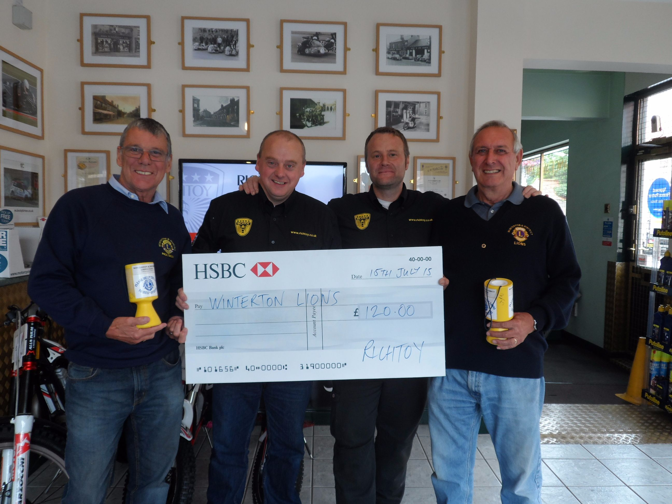Richtoy hand over a cheque of £120 to local charity Winterton Lions